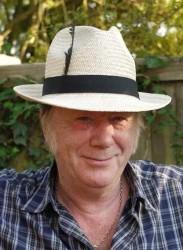 Alan Howe, white hat blue shirt