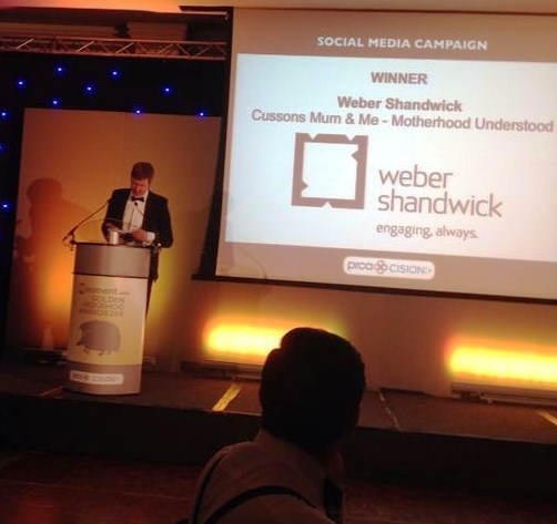 Cision's Jody Clark presents the award to Weber Shandwick for best social media campaign