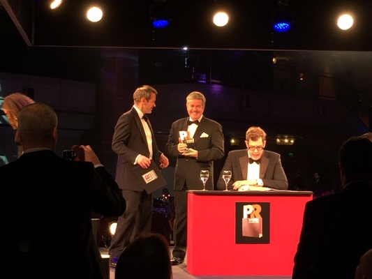 Vuelio's managing director, Charlie O'Rourke (center) presents the award for Best PR Event to Premier
