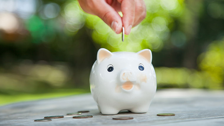 Saving money with a piggybank