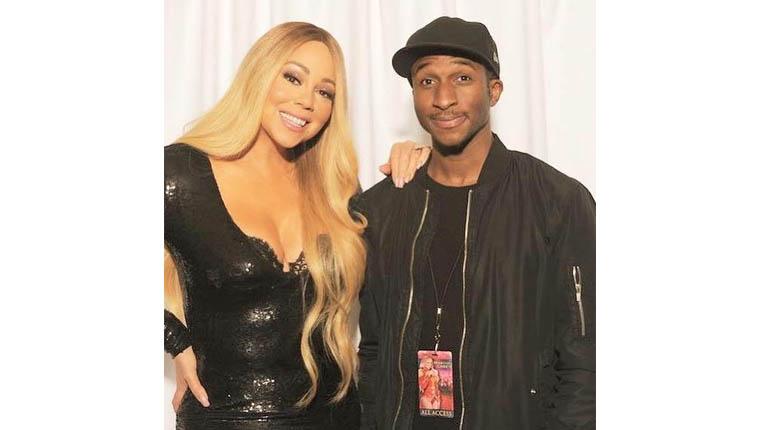 Sam Ajilore and Mariah Carey